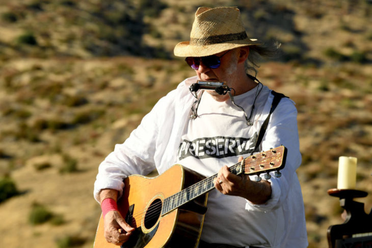 Neil Young performs at the Harvest Moon benefit